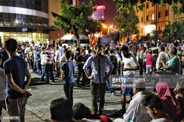 Relatives of the Ataturk Airport suicide bomb attack victims wait outside Bakirkoy Sadi Konuk Hospital in the early hours of June 29 2016 in Istanbul...