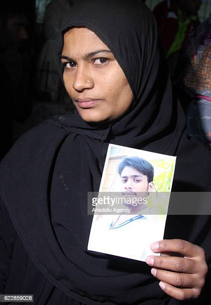 Relatives of the blast victims wait outside the hospital in the Hub district Karachi Pakistan on November 12 2016 At least 43 people have been killed...