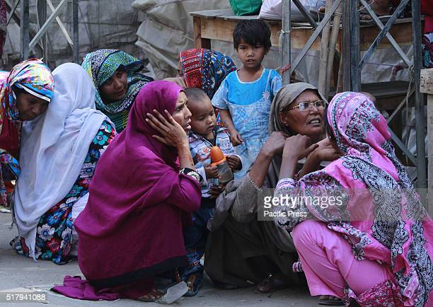 Relatives of the bomb blast grieving at the blast site Pakistani officials cordon off the site where the bomb blast killing at least 73 and injured...