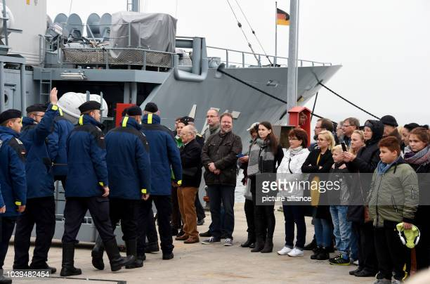 Relatives of the crew members stand on the pier before the departure of the Elbeclass 'Main' tender with ship number A 515 at the German naval base...
