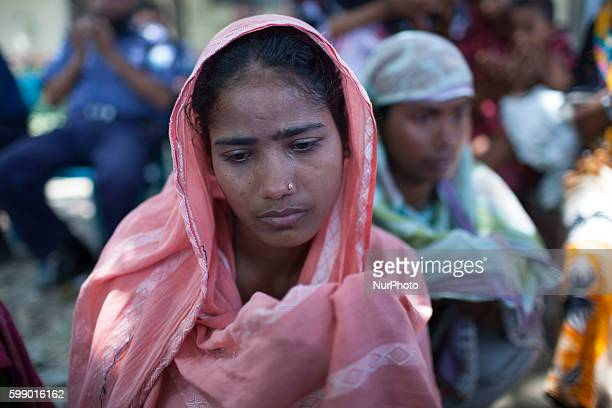 Relatives of the dead and missing workers mourn as they gather in remembrance of those who lost their lives in the collapse of the Rana Plaza...