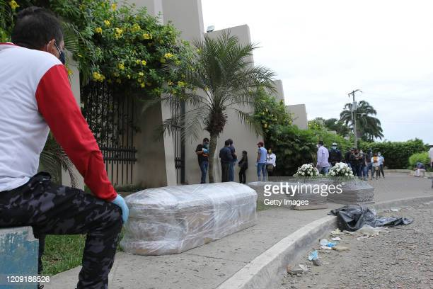 Relatives of the deceased line up for the funeral outside the Durán Cemetery on April 5, 2020 in Guayaquil, Ecuador. Guayaquil is the most affected...