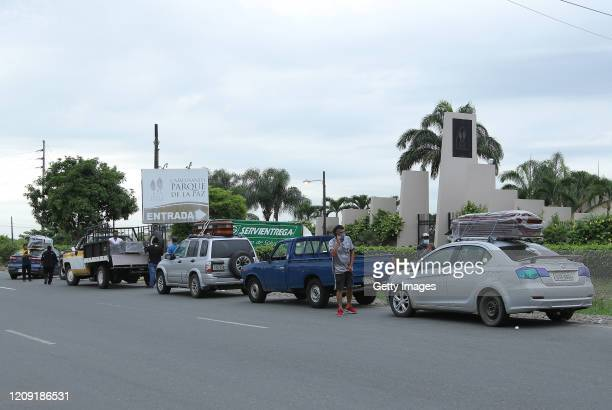 Relatives of the deceased line up for the funeral outside the Durán Cemetery on April 5 2020 in Guayaquil Ecuador Guayaquil is the most affected city...