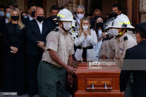 Relatives of the former governor of Jalisco Aristoteles Sandoval -murdered in Puerto Vallarta early this week- walk next to his coffin on its way to...