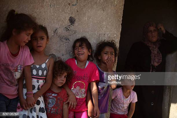 Relatives of the four Palestinian children from the Baker family whom medics said were killed by a shell fired by an Israeli naval gunboat mourn...