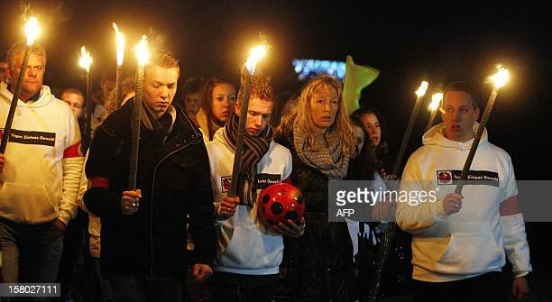 Relatives of the late linesman of the SC Buitenboys football club Richard Nieuwenhuizen take part in a silent march in his memory in Almere on...