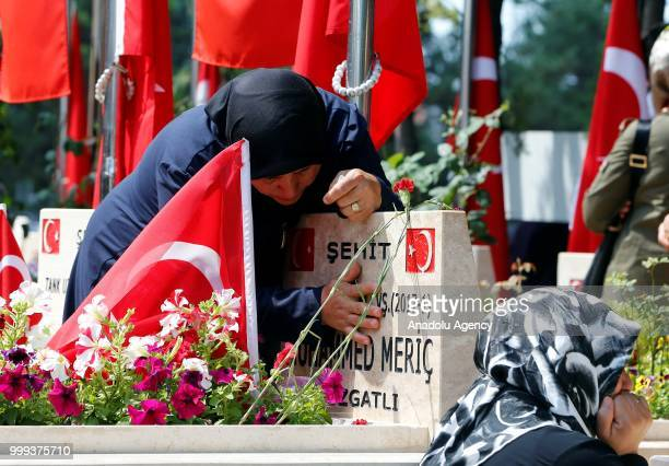 Relatives of the martyr's mourn near graves during the July 15 Democracy and National Unity Day to mark July 15 defeated coup's 2nd anniversary at...