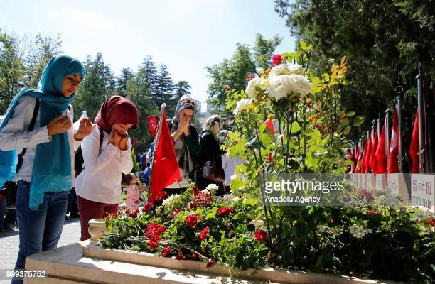 Relatives of the martyr's pray near graves during the July 15 Democracy and National Unity Day to mark July 15 defeated coup's 2nd anniversary at...