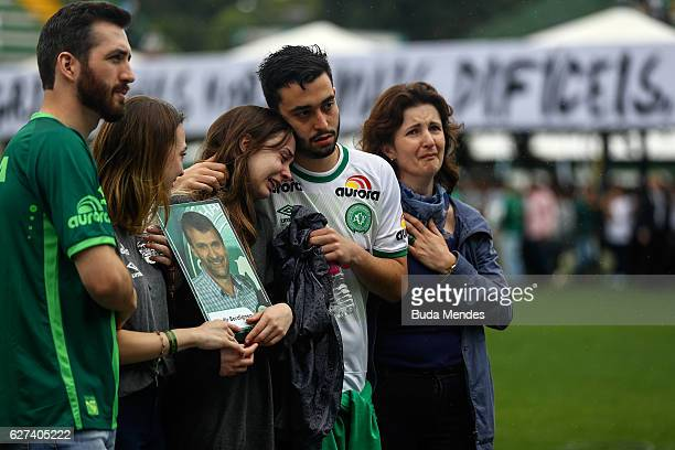 Relatives of the members of Brazilian team Chapecoense Real pay a tribute at the club's Arena Conda stadium in Chapeco in the southern Brazilian...