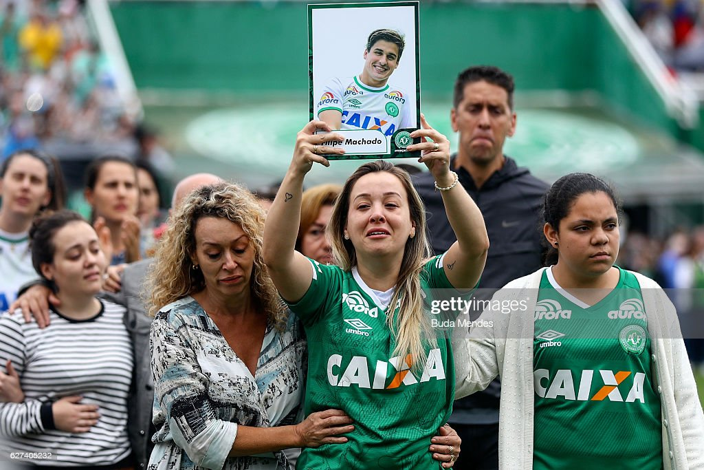 Relatives of the members of Brazilian team Chapecoense Real pay tribute at the club's Arena Conda stadium in Chapeco, in the southern Brazilian state of Santa Catarina, on December 03, 2016. The players were killed in a plane accident in the Colombian mountains. Players of the Chapecoense team were among the 77 people on board the doomed flight that crashed into mountains in northwestern Colombia. Officials said just six people were thought to have survived, including three of the players. Chapecoense had risen from obscurity to make it to the Copa Sudamericana finals scheduled for Wednesday against Atletico Nacional of Colombia.