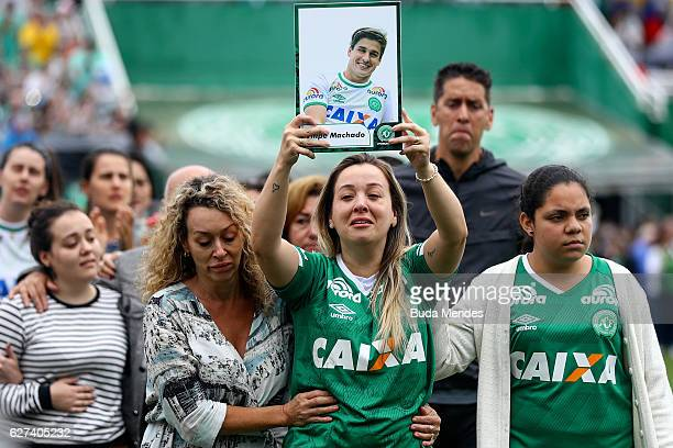 Relatives of the members of Brazilian team Chapecoense Real pay tribute at the club's Arena Conda stadium in Chapeco in the southern Brazilian state...