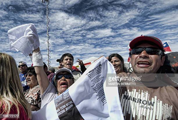 Relatives of the miners trapped in the San Esteban gold and copper mine in Copiapo 800 km north of Santiago celebrate as a new drilling machine...