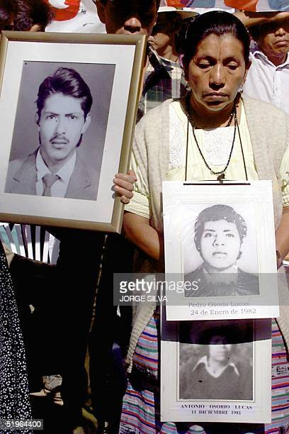 Relatives of the missing detained during the past conflict carrried photographs if their family members during a demonstration in Guatemala City 25...