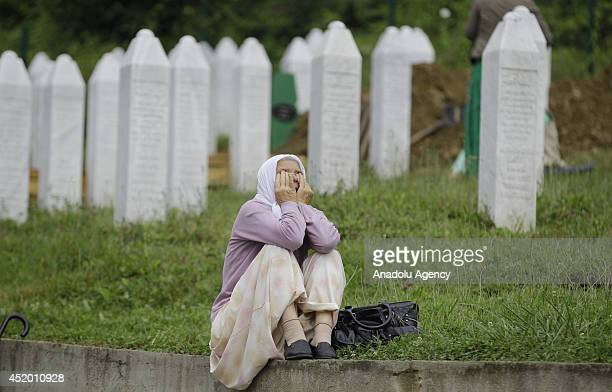 Relatives of the Srebrenica victims mourn for the 175 newly identified victims on July 11 at SrebrenicaPotocari Memorial and Cemetery for the mass...