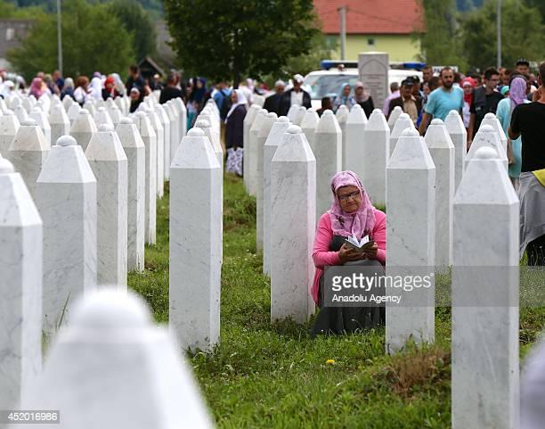 Relatives of the Srebrenica victims mourn near the tombs at Srebrenica-Potocari Memorial and Cemetery in Srebrenica, Bosnia and Herzegovina on July...