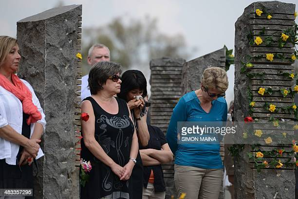 Relatives of the ten killed Belgian Para commandos who were part of the peace keeping mission under the UN flag pay their respects on April 08 2014...