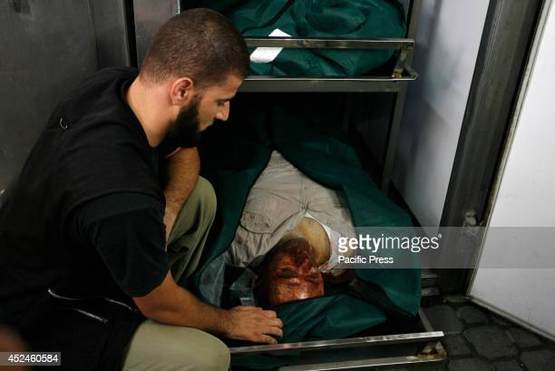 Relatives of the three members of alShair family killed by an Israeli air strike in Khan Yunis in the southern Gaza strip mourn The death toll in...