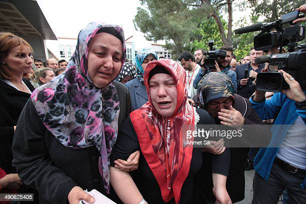 Relatives of the trapped miners react near the mine May 15, 2014 in Soma, a district in Turkey's western province of Manisa, Turkey. An explosion and...