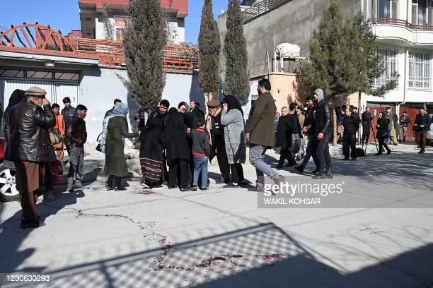 Relatives of the victims arrive at the site following gunmen shot dead two Afghan women judges working for the Supreme Court, in Kabul on January 17,...