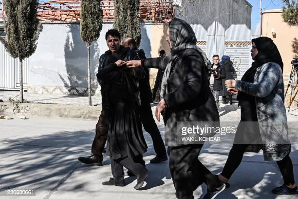 Relatives of the victims arrives at the site following gunmen shot dead two Afghan women judges working for the Supreme Court, in Kabul on January...