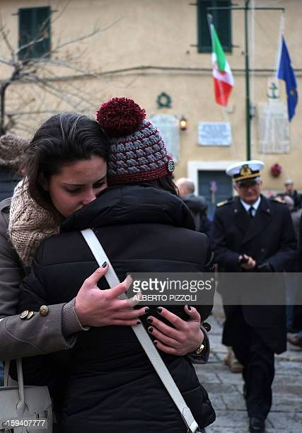 Relatives of the victims cry during the unveiling ceremony of a plaque with the names of the victims of the Costa Corncordia cruise ship in the port...
