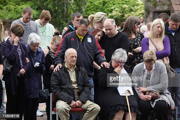 Relatives of the victims of gunman Derrick Bird including Ted Scones and Betty Scones with Sue and Tracey wife and daughter of David Bird observe a...