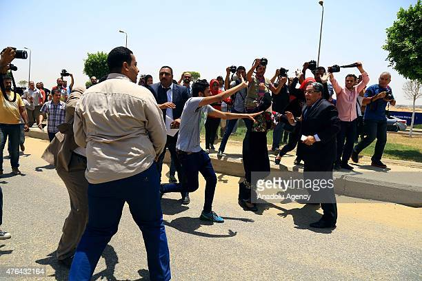 Relatives of the victims of Port Said massacre chant slogans against the lawyers of the defendants outside the court after the trial of Port Said...