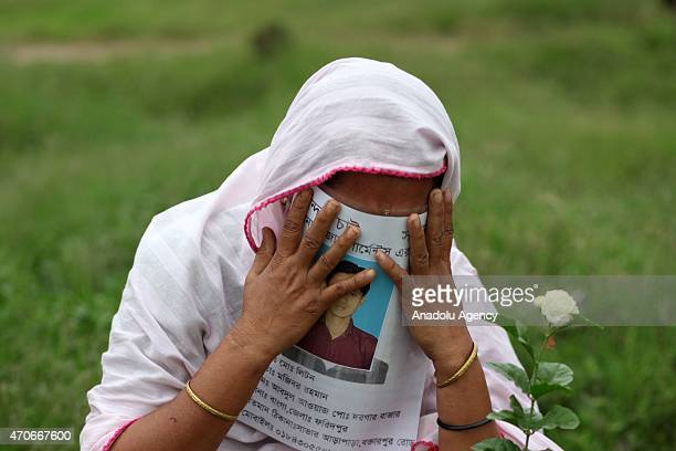 Relatives of the victims of Rana Plaza building collapse mourn at Jurain Graveyard on the second anniversary of Rana Plaza building collapse at...