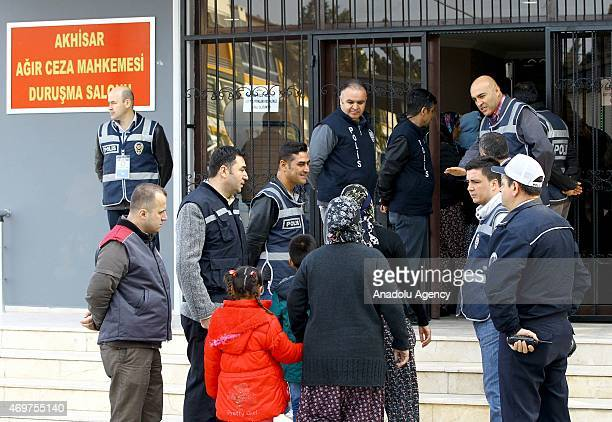 Relatives of the victims of Soma mining disaster arrive at the Akhisar High Criminal Court for the trial of the Soma mine disaster case in Manisa,...