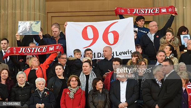 Relatives of the victims of the 1989 Hillsborough disaster gather on the steps of St George's Hall in Liverpool north west England on April 27 in...