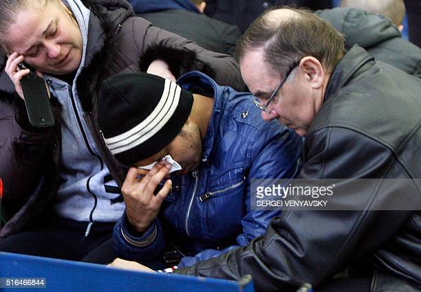 Relatives of the victims of the airplane crash mourn at the airport in RostovonDon on March 19 2016 All sixtytwo people on board a flydubai Boeing...