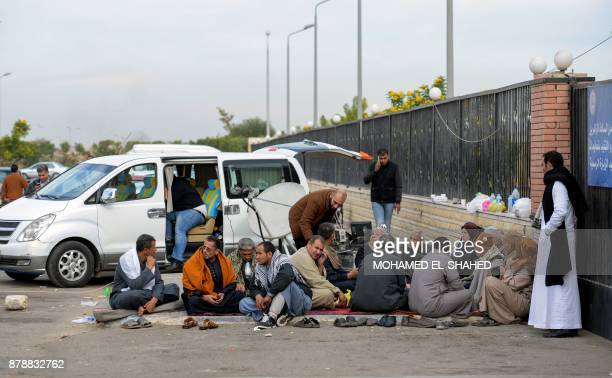 Relatives of the victims of the bomb and gun assault on the North Sinai Rawda mosque sit outside the Suez Canal University hospital in the eastern...