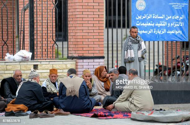 TOPSHOT Relatives of the victims of the bomb and gun assault on the North Sinai Rawda mosque wait outside the Suez Canal University hospital in the...
