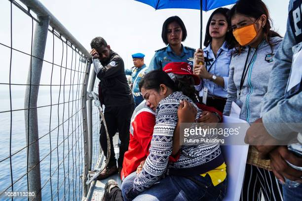 Relatives of the victims of the illfated Lion Air flight JT 610 toss flower petals into the water as they visit the site of the crash in the Java Sea...