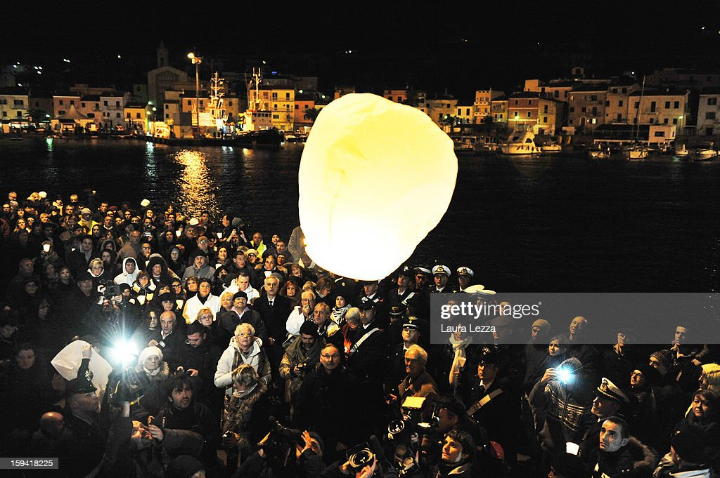 Relatives of the victims of the sunken Costa Concordia release a lantern into the sky after a minute of silence to mark the exact time the ship crashed, on January 13, 2013 in Giglio Porto, Italy. A year after the sinking of the ship Costa Concordia, relatives of the victims, survivors, island residents, law enforcement and institutions gathered to mark the first anniversary and commemorate the dead. More than four thousand people were on board when the ship hit a rock off the Tuscan coast, killing 32 and leaving two people missing.