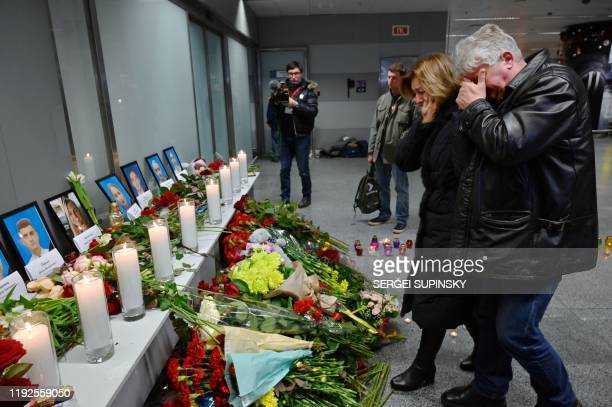 Relatives of the victims of the Ukraine International Airlines Boeing 737800 crash in the Iranian capital Tehran react by a memorial at the Boryspil...
