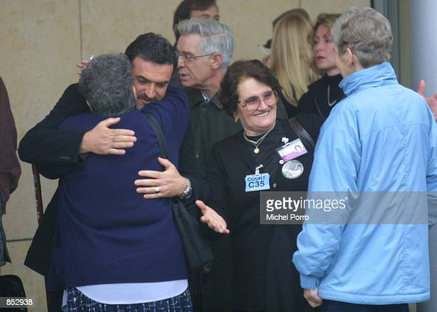 Relatives of the victims that were killed in the Pan Am Flight 103 bombing over Lockerbie, Scotland, congratulate and hug each other at the entrance...