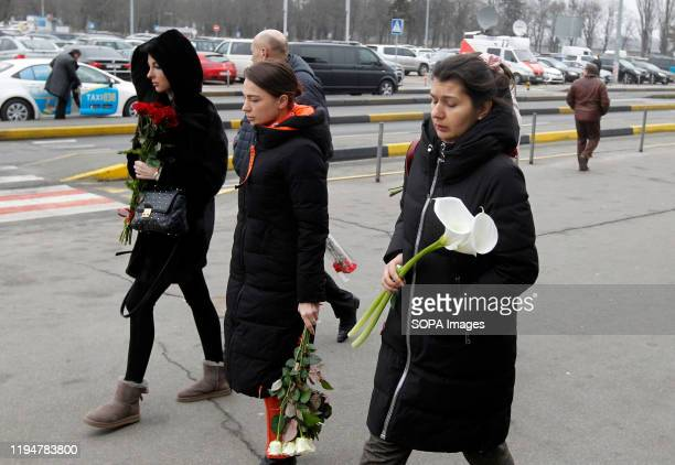 Relatives of the victims who died from a plane crash in Iran arrive at the Boryspil International Airport to honour their memorial ceremony in Kiev....