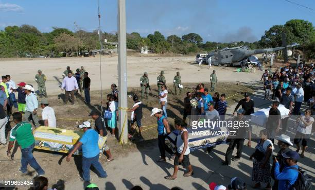 Relatives of thirteen people killed when a military helicopter fell on a van in Santiago Jamiltepec Oaxaca state Mexico carry the coffins of the...