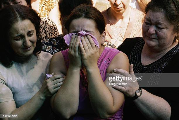 Relatives of those killed during the siege in Beslan weep September 4 2004 in the province of North Ossetia Russia President Vladimir Putin ordered a...