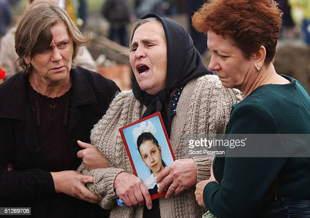 Relatives of those killed in the Beslan school massacre bury the dead for the third day September 7 2004 in Beslan Russia The carnage began amid a...