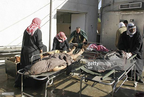Relatives of three killed Sahwa or 'Awakening' militiamen arrive at the morgue to collect the bodies in the north eastern town of Baquba on December...