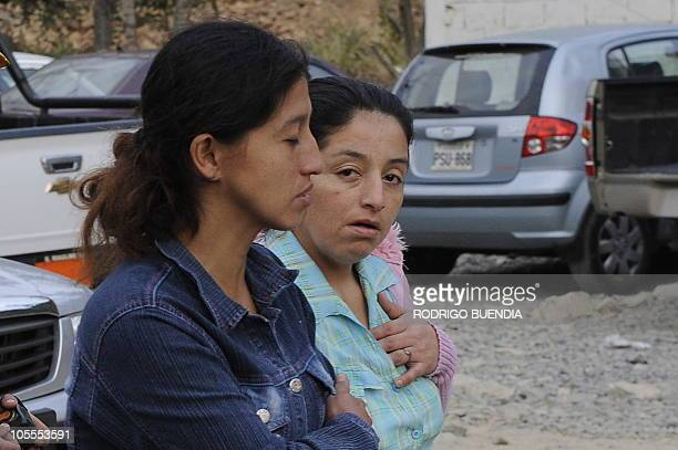 Relatives of trapped miners are seen outside of the Casa Negra mine where four are trapped inside after it collapsed in Portovelo Ecuador on October...