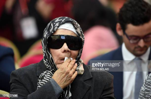 Relatives of Tunisian victims attend the closing conference of the Truth and Dignity Commission in the capital Tunis on December 14 2018 The Truth...