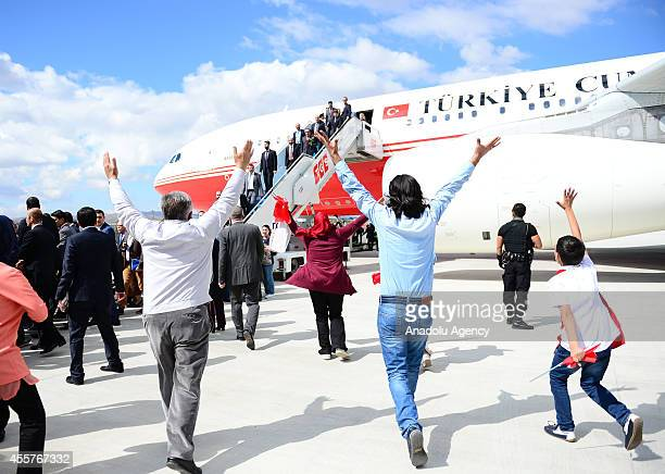 Relatives of Turkish freed hostages who have been brought to Ankara after being seized by the Islamic State of Iraq and the Levant in the northern...