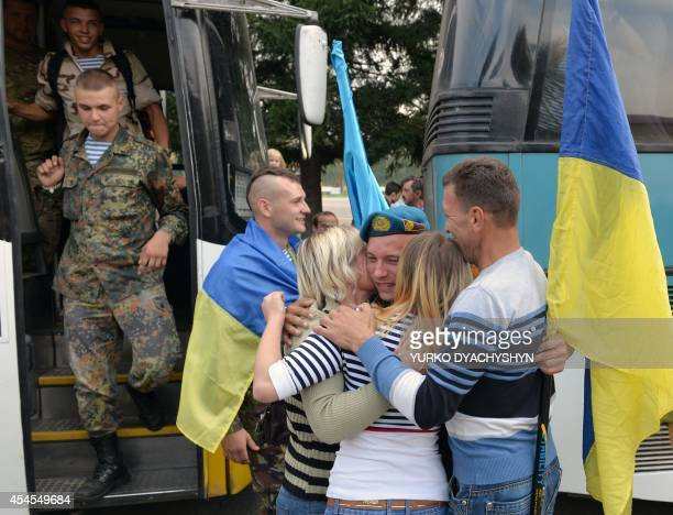 Relatives of Ukrainian servicemen react during a welcome ceremony in the western city of Lviv on September 3 2014 Some 146 soldiers returned home...
