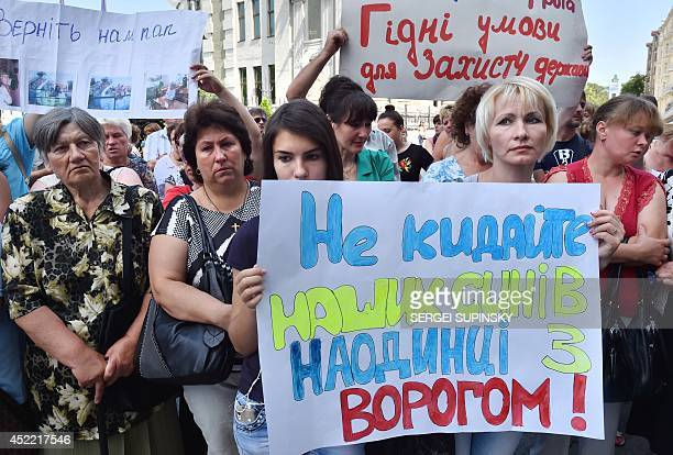 Relatives of Ukrainian servicemen who fight proRussian militants in the east of the country hold placard reading Do not leave our sons alone with the...