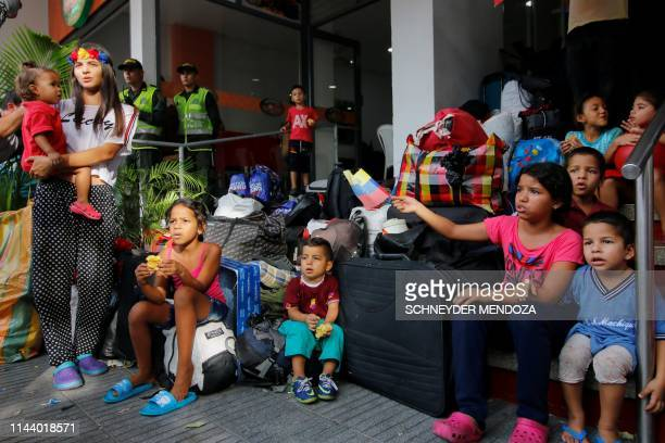 Relatives of Venezuelan soldiers and policemen who deserted to Colombia stay outside a hotel where they were staying in after being evicted in Cucuta...