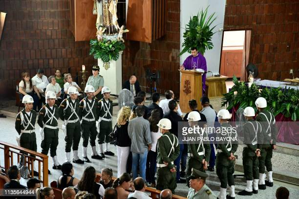 Relatives of Venezuelan tropical music singer Pastor Lopez aka el Indio Lopez attend mass during his wake in Cucuta northeastern Colombia on April 7...