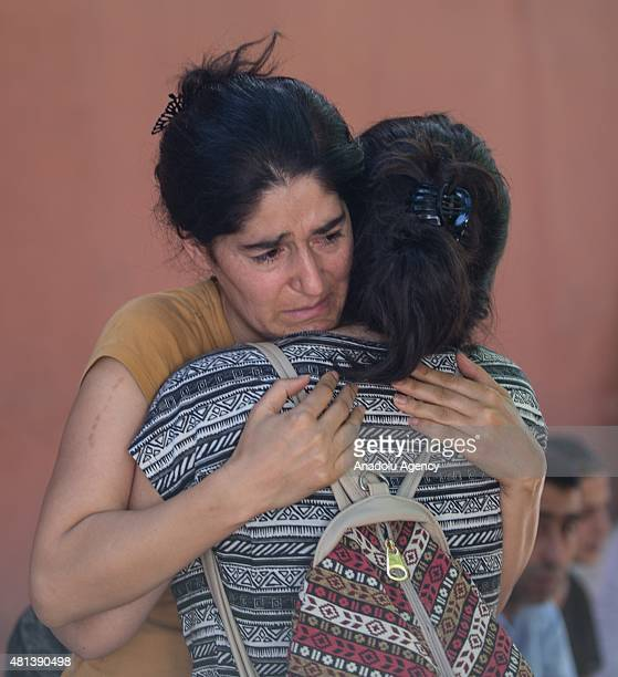 Relatives of victims cry at the site of an explosion targeting a cultural center in Suruc district of Sanliurfa Turkey on July 20 2015 At least 27...